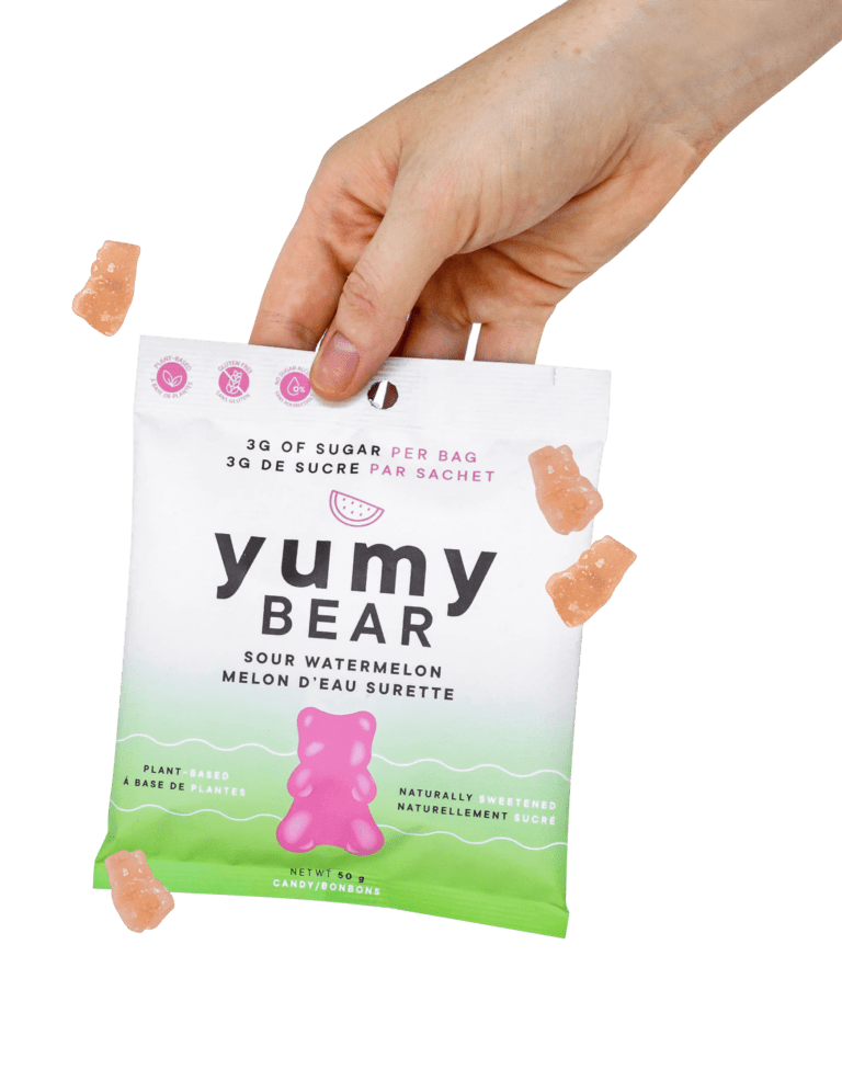 Hand Holding Plant-Based, Low Sugar Candy Pack